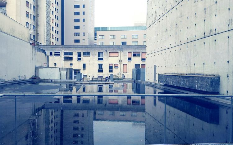 City Reflection Water Building Exterior Outdoors Horizontal No People Day Built Structure Reflection City Water Architecture Building Exterior Built Structure Outdoors Horizontal