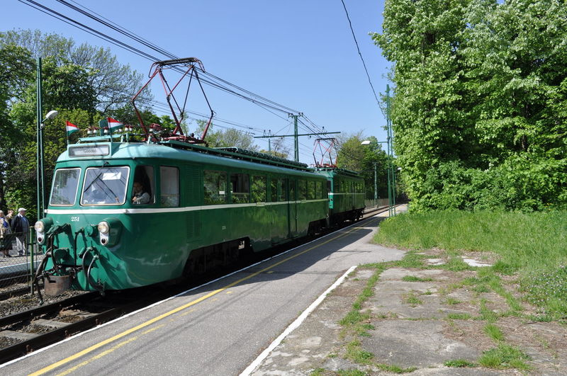 Cable Day Grass Green Color Mode Of Transport Nature No People Outdoors Public Transportation Railroad Track Road Sky Train - Vehicle Transportation Tree