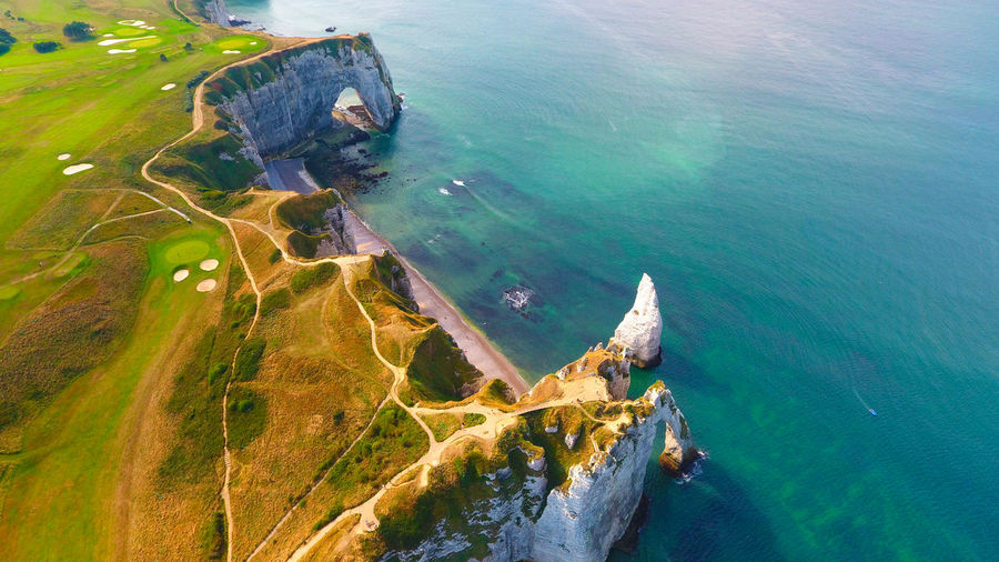 Aerial view of mountain by sea at etretat