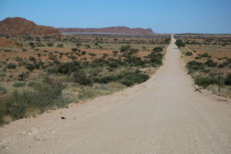 Empty road through desert