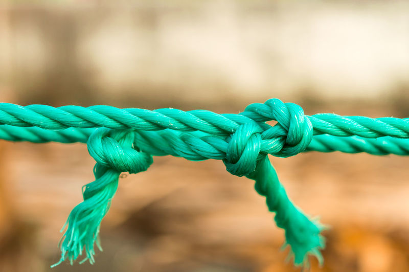 Close-up of rope tied to metal