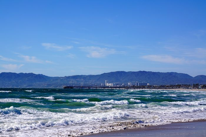 Venice Pier and Santa Monica Beach Beauty In Nature Blue Coastline Idyllic Mountain Mountain Range Nature No People Outdoors Sand Scenics Sea Shore Sky Tranquil Scene Tranquility Water Waterfront Wave