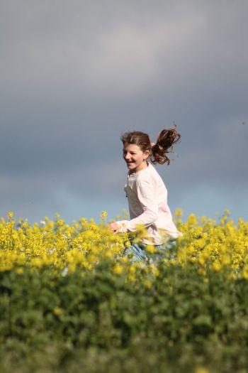 Full length of girl on field against sky