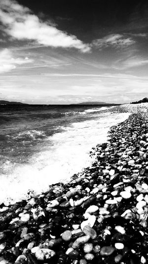 EyeEm Man Black And White Blackandwhite Photography Water Sea Wave Beach Sky Horizon Over Water Pebble Beach Shore Low Tide Ocean Coastline Coast Seascape
