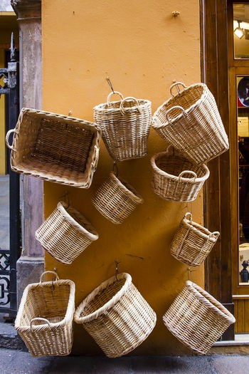 Various Whicker Basket Hanging On Wall