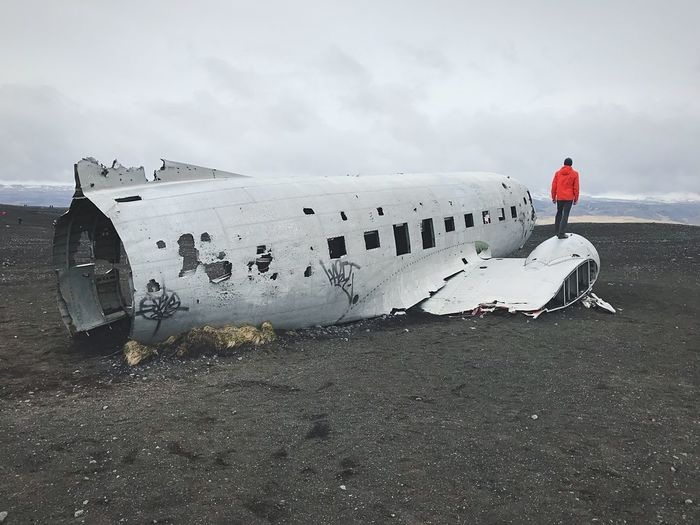 Airplane Iceland Explore Abandoned Real People Sky Lifestyles Water One Person Cloud - Sky Men Day Full Length Beauty In Nature Tranquility Outdoors Cold Temperature Air Vehicle Side View Crash Adult Travel Mode Of Transportation Aerospace Industry Adult Damaged Crash Travel Standing Land