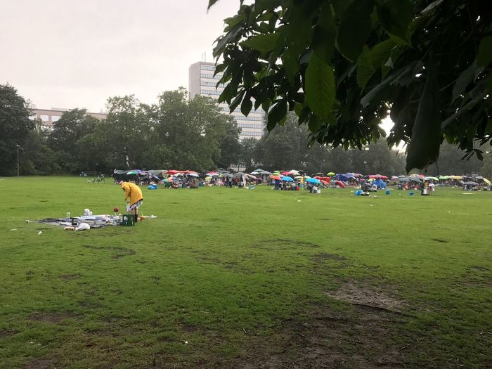 Rain Picnic One Woman Plant Real People Tree Group Of People Grass Crowd Nature Land Field Day Park Sky Lifestyles Leisure Activity Outdoors