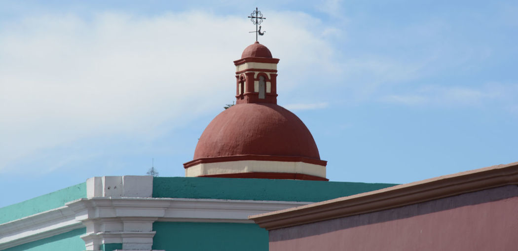 Weather vane on dome of building