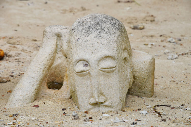 All those questions in my head... Aged Ancient Antique Asian  Beach Carved Decor Decoration Dig Exterior Design Hand HEAD Old Philosopher Q Sand Sandstone Sculpture Statue Thai Thinker Spotted In Thailand Telling Stories Differently