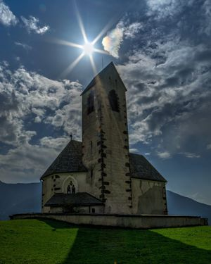 Church in Val di Funes. Sunbeam Architecture Sunlight Built Structure Sun Building Exterior Sky Lens Flare Grass Cloud - Sky Sunny Church Field DayNature Shadow Italy Outdoors Lawn Place Of Worship Vapor Trail Exterior Bright