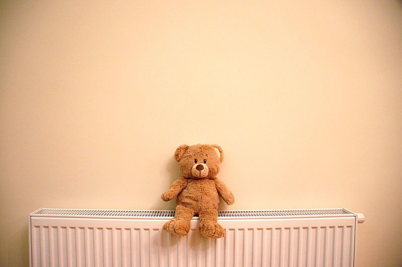 Teddy bear sitting on a radiator Wall Copy Space Ecology Home Warmth Radiator Energy Toy Teddy Bear Stuffed Toy Childhood Indoors  No People Bear Stuffed