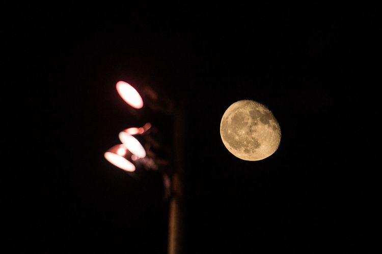 Friday Night Lights Lights Moon Moon Shots Night Scene Stadium Lights Astronomy Burning Close-up Flame Holding Illuminated Moon Moon Surface Nature Night Night Sky Outdoors Sky
