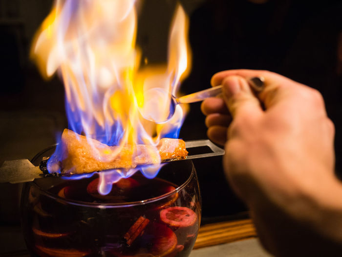 Feuerzangenbowle New Year New Year's Eve Burning Human Hand Fire Flame Heat - Temperature Hand Human Body Part Food And Drink Motion One Person Indoors  Drink Close-up Glass Holding Punch Alcohol Alcoholic Drink Mulled Wine Feuerzangenbowle Celebration Sugar Wine The Foodie - 2019 EyeEm Awards