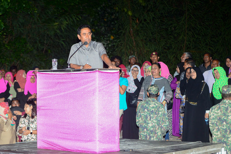 Maldives President Abdulla Yameen Abdul Gayoom speaking at the campohn rally held on west park, male' maldives on 7 February 2018 Maldives President President Abdulla Yameen Abdul Gayoom Full Length Large Group Of People Outdoors Pink Color Rally Standing Togetherness Women