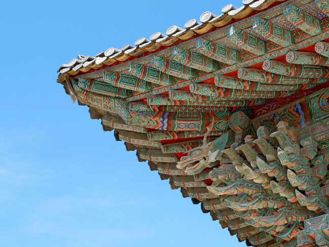 Traditional roof at Korean temple. Ancient Korean Traditional Architecture Roof Wood Architecture Art And Craft Building Building Exterior Built Structure Clear Sky Creativity Day Detail Korean Style Ornate Outdoors Pattern Place Of Worship Religion Spirituality Temple Traditional Zen