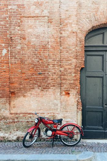 Bicycle Transportation Stationary Mode Of Transport Outdoors No People Brick Wall Day Architecture Built Structure Building Exterior Red Multi Colored Motorcycle Italy Deterioration Rustic