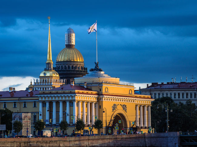 Sunlit Admiralty building, tower and Saint Isaac's Cathedral in background at sunset Blue Hour Historical Building Power Russian Navy Tourist Attraction  Traffic Traffic Signs Ambitious Architecture Building Exterior Built Structure City Cloud - Sky Day Dome Flag Headquarters Nature Nevskiy Prospekt Outdoors Patriotism Sky Sunset Travel Destinations Tsar