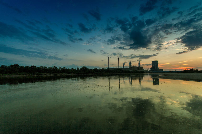 Power Stations Beauty In Nature Blue Calm Cloud Cloud - Sky Cloudy Idyllic Nature No People Non-urban Scene Outdoors Reflection Rippled Scenics Sky Standing Water Sunset Tranquil Scene Tranquility Water Weather