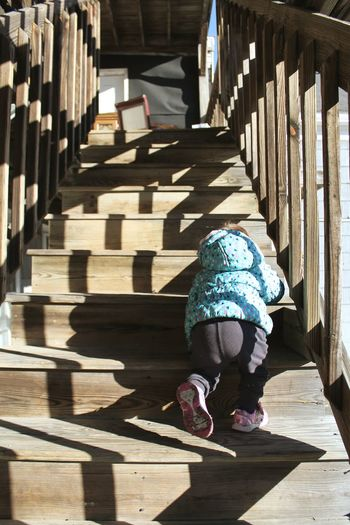 Kids EyeEm Best Shots Shadows & Lights Little Girl Crawling Childhood Cold Temperature Learning Child Working Full Length Shadow Sunlight Wood - Material Steps And Staircases Stairway Stairs Staircase Railing Hand Rail Steps