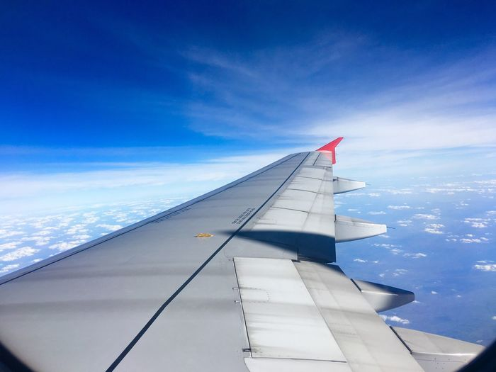 Aircraft wing Airplane Sky Cloud - Sky Transportation Travel Blue Journey Aircraft Wing Air Vehicle Day Flying No People Airplane Wing Nature Scenics Outdoors Beauty In Nature