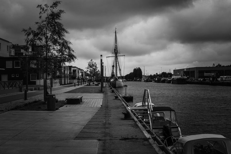 Architecture Built Structure Building Exterior Sky Cloud - Sky Outdoors Day No People Water Harbor Nautical Vessel City Nature Urban Exploration Blackandwhite Black And White Sailing Travel Sailboat Sailing Ship Transportation Mode Of Transport Mast Ship Documenting Gävle