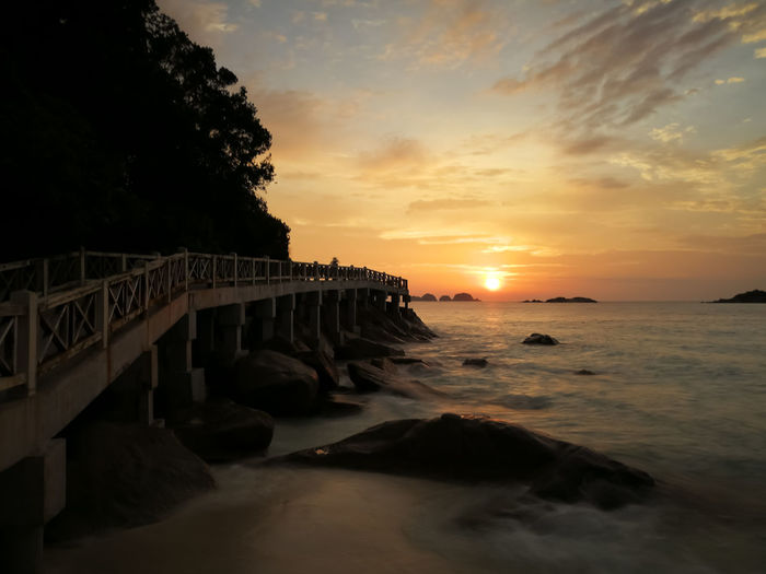 Sunset in Redang. Sunset Sky Water Sea Cloud - Sky Scenics - Nature Architecture Beauty In Nature Built Structure Orange Color Nature Beach Land Motion No People Sun Bridge Tranquil Scene Idyllic Horizon Over Water Outdoors