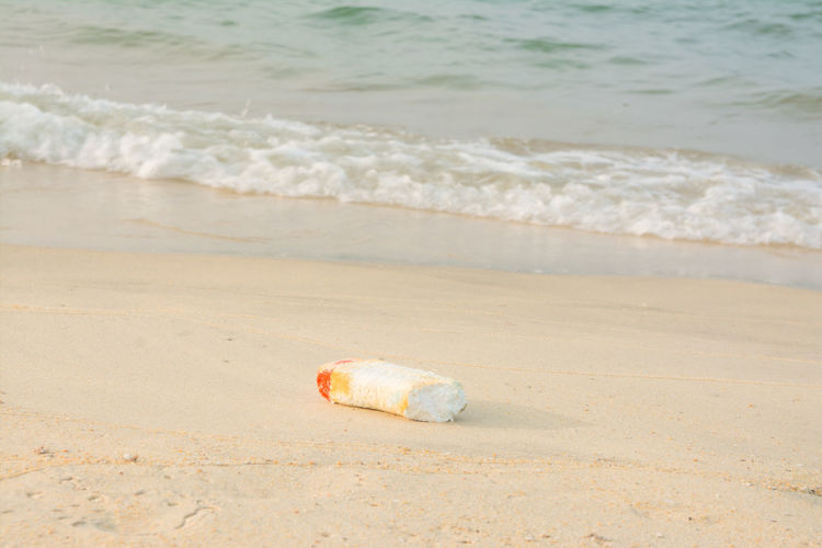 View of abandoned bottle on beach