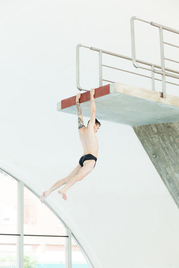 Climbing Concrete Diving Diving Board Flying Pool Sureal Surealism Suspended Tattoed Try