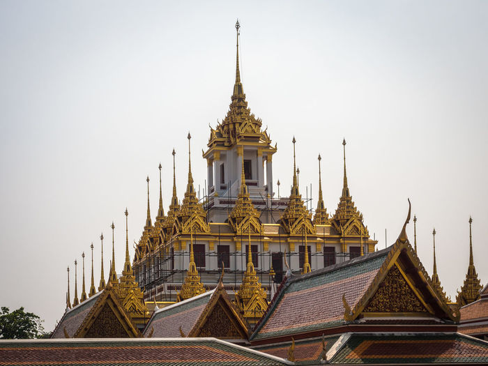 Low angle view of loha prasat temple in bangkok, thailand