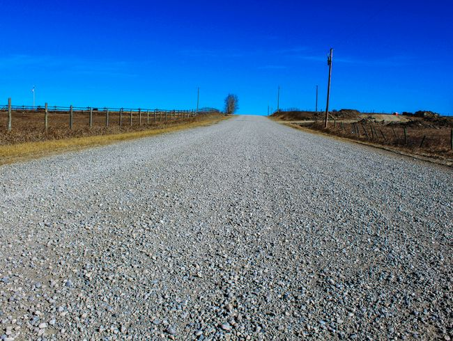 Rural Rural Roads Gravel Road Country Road Blue Sky No Clouds Blue Wave Prairie Scenes Prairie Canada Alberta Eyeemawards16 MeinAutomoment Finding New Frontiers Miles Away