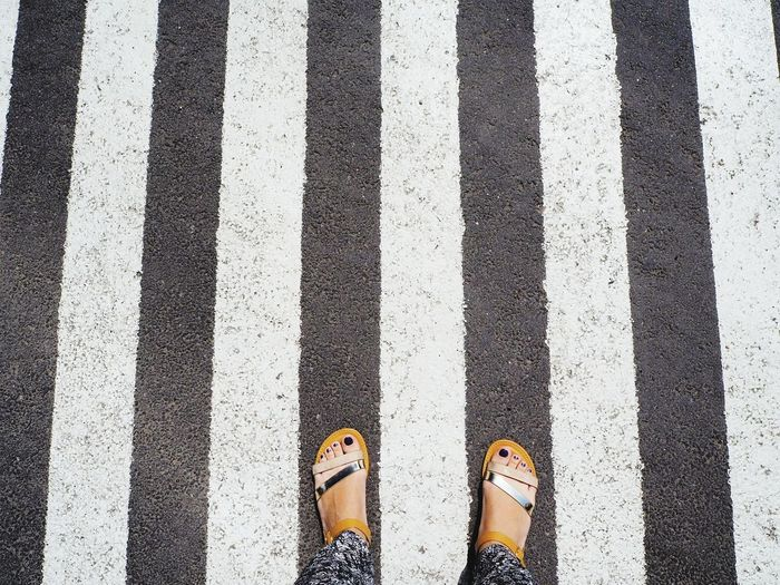 Striped Human Leg Human Foot Low Section Standing Pattern Outdoors LINE Close-up Interesting Zebra Crossing Parallel Lines Feetselfie Gold Sandals Urbanphotography Walking Around Taking Pictures Walking Around The City  Olympus Om-d E-m10 EyeEmNewHere Streetphotography My View Simplicity Neon Life Breathing Space Mix Yourself A Good Time Paint The Town Yellow Be. Ready. Stories From The City International Women's Day 2019