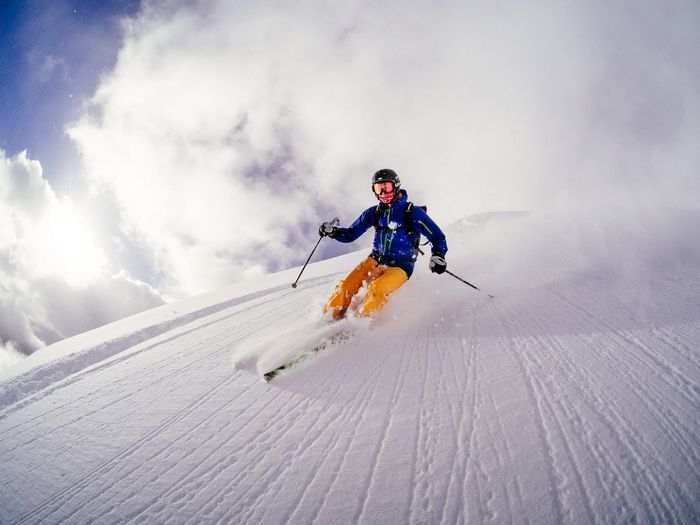 Low Angle View Of Man Skiing On Mountain