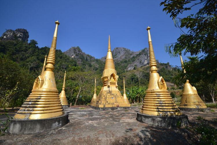 Historic Gold Stupas Against Clear Sky