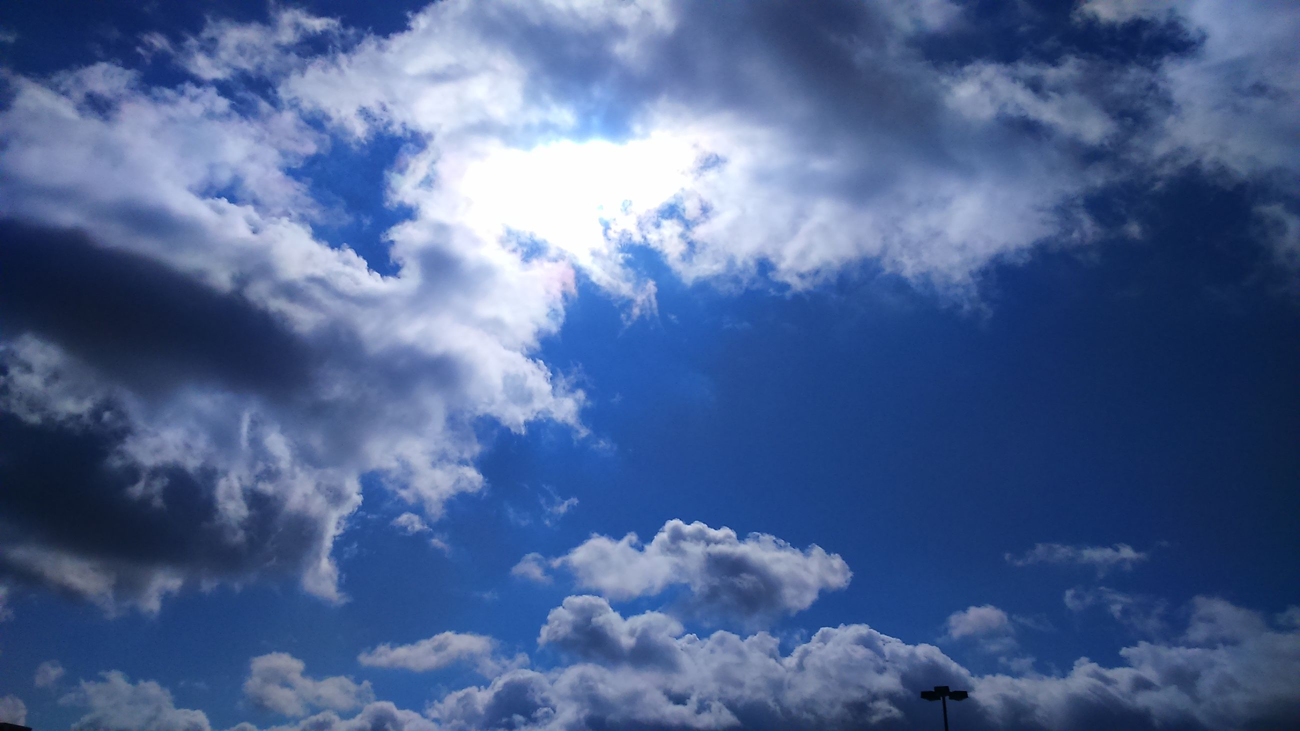 low angle view, sky, cloud - sky, sky only, blue, beauty in nature, tranquility, cloudy, nature, scenics, cloudscape, cloud, tranquil scene, backgrounds, white color, idyllic, fluffy, day, outdoors, no people
