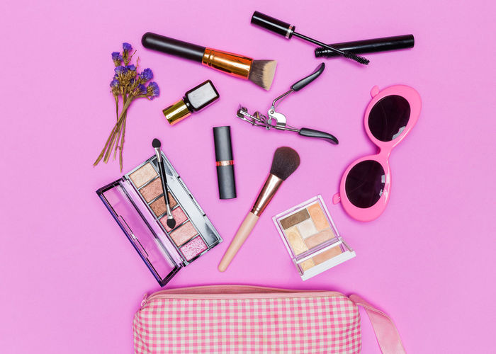 High Angle View Of Beauty Products On Pink Background