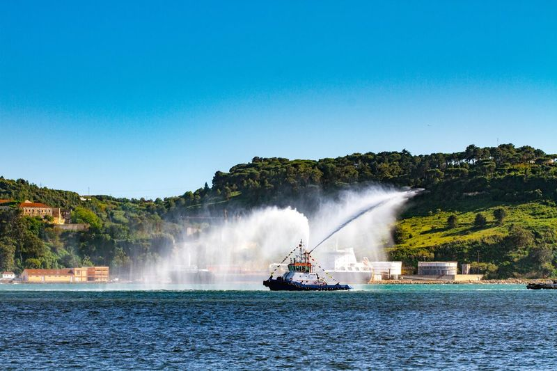 Water Spraying Motion Outdoors Firefighter Day Sky Tejo No People Nautical Vessel Lisboa Lisbon River