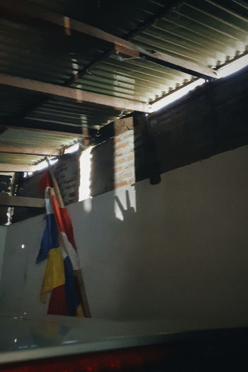 Close-up of piano hanging on wall