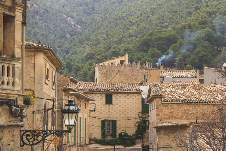 spanish village on mallorca island Architecture Awesome Spain Trip Building Exterior Built Structure Explore Explore Mallorca Explore Spanish Streets Historic Building History Mountain No People Outdoors Residential District Residential Structure Street Summer In Spain Town Vacation The Architect - 2016 EyeEm Awards