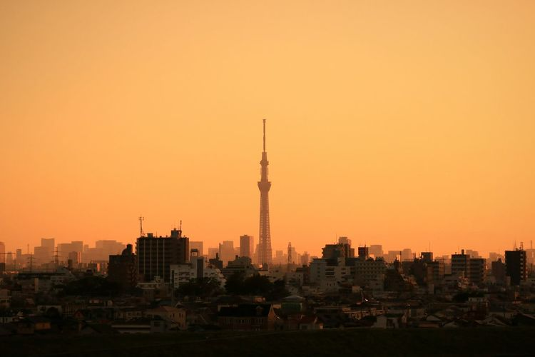 Tokyo sky tree against sky during sunset in city