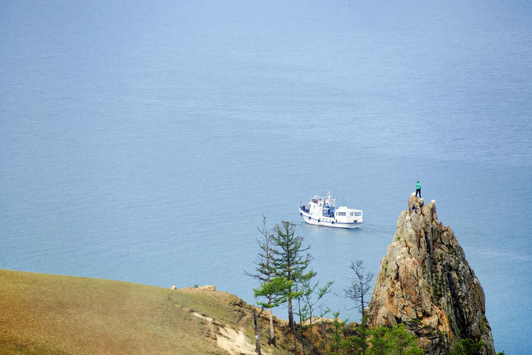 Scenic view of ship sailing on sea