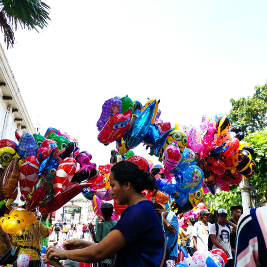 Low angle view of people in traditional clothing against sky
