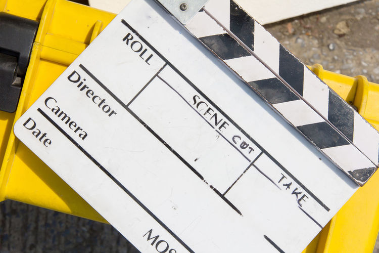 close up image of Film Slate Filming Broadcasting Clapper Board Clapperboard Close-up Communication Day Film Industry Film Slate Filming Location No People Number Outdoors Studio Shot Yellow