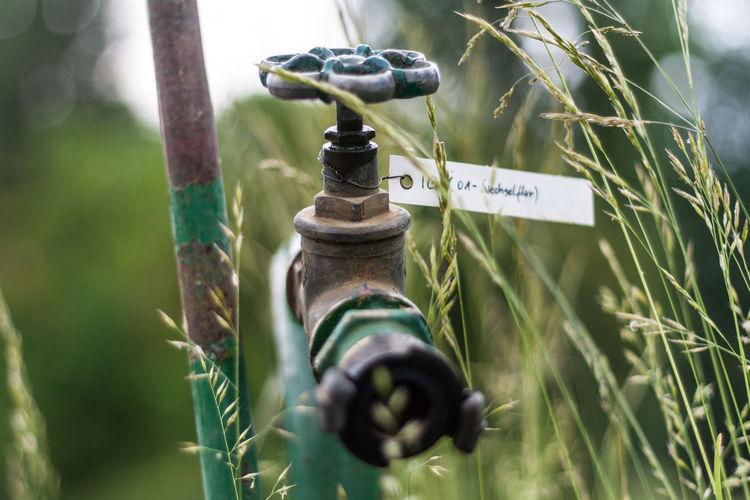 Close-Up Of Sprinkler At Farm