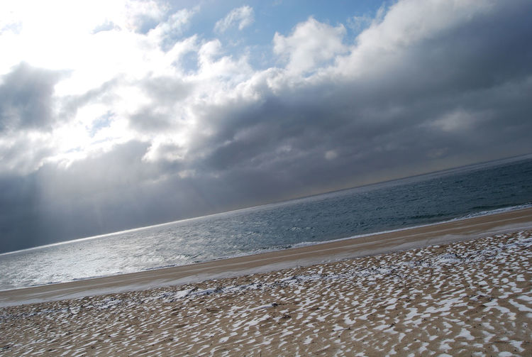 Beach Beauty In Nature Cape Cod Massachusetts Dramatic Sky Idyllic Nature No Filter, No Edit, Just Photography Sand Scenics Sea Seascape Shore Sky Snow Sprinkled Beach Sunlight Tranquility Water Winter Time