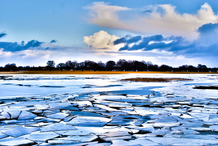 Drifting ice floes in the Elbe Beauty In Nature Calm Cold Cold Temperature Idyllic Lake Lakeshore Outdoors Reflection Rippled Scenics Sky Standing Water Tranquil Scene Tranquility Water Waterfront Winter