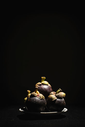 Mangosteen Vietnam Vietnamese Food Black Background Close-up Copy Space Food Food And Drink Freshness Fruit Fruit Photography Fruits Healthy Eating Indoors  Mangosteen Mangosteen Fruit No People Raw Potato Still Life Studio Shot Table
