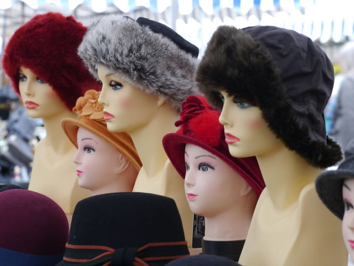 Various hats on mannequin head at store