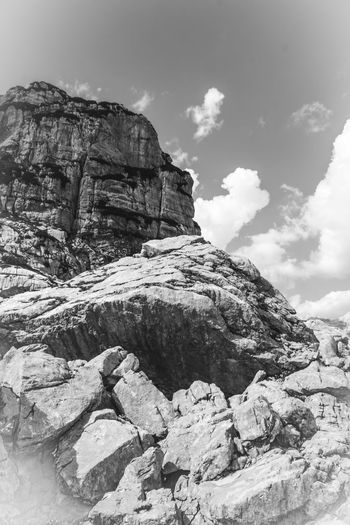 Peek of a mountain near Tarvisio (Italy) Peek Tarvisio Beauty In Nature Black And White Cliff Cloud - Sky Clouds Day Geology Italy Landscape Mountain Nature No People Outdoors Physical Geography Rock - Object Rock Formation Scenics Sky Tranquility
