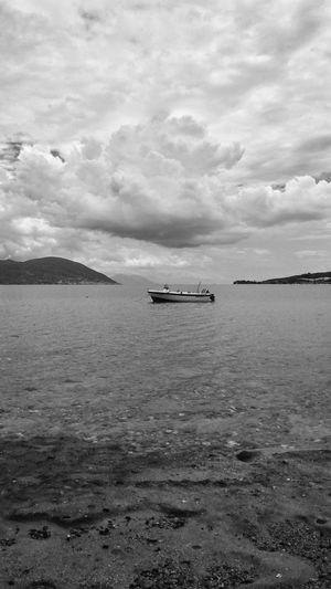 EyeEm Man Black And White Blackandwhite Photography Sea Water Nautical Vessel Beach Sky Horizon Over Water Cloud - Sky Landscape Calm Dramatic Sky Mast Sandy Beach Boat Ocean Cloud Atmospheric Mood A New Beginning