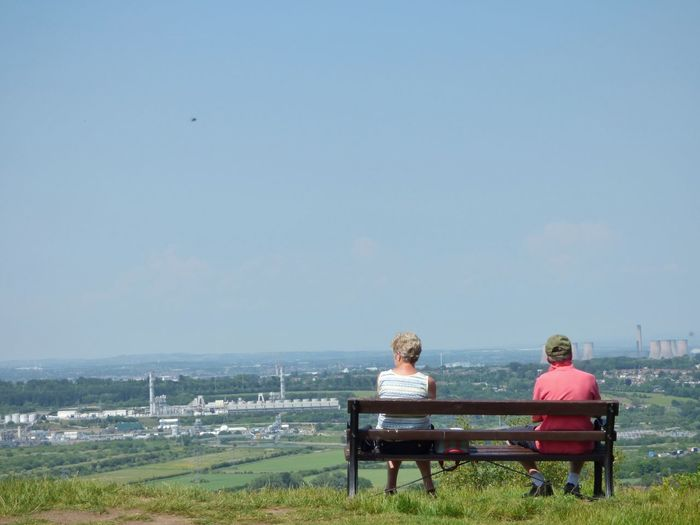 My mum and dad enjoying the view // Amazing View Beautiful Bench Cheshire Cheshirelife Clear Sky Couple England EyeEm Best Shots Eyeem Market Frodsham ICI Image Industrial Mike Whitby Mum And Dad Photo Photography Relaxation Sitting Sitting Stock Image Stock Photo Taking Photos View